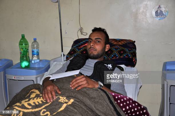 A wounded Syrian proregime fighter is pictured in a hospital in Syria's eastern city of Deir Ezzor on February 8 2018 The Syrian government blasted...