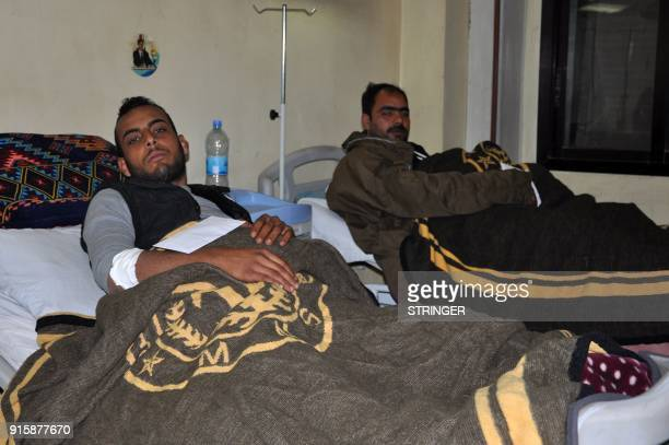 Wounded Syrian proregime fighters are pictured in a hospital in Syria's eastern city of Deir Ezzor on February 8 2018 The Syrian government blasted...