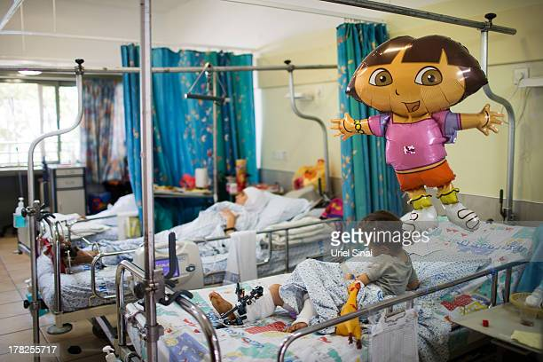 A wounded Syrian woman and her child treated at the Israeli Ziv hospital on August 28 2013 in the northern town of Safed Israel About 140 Syrians who...