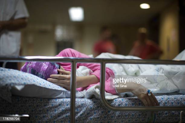 A wounded Syrian woman is treated at the Israeli Ziv hospital on August 28 2013 in the northern town of Safed Israel About 140 Syrians who have been...