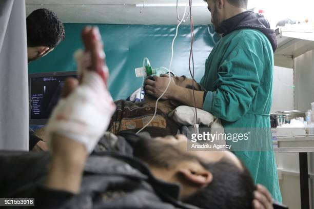 Wounded Syrians receive medical treatment at a hospital after Assad Regime's airstrikes hit Zamalka town of Eastern Ghouta deescalation zone in...