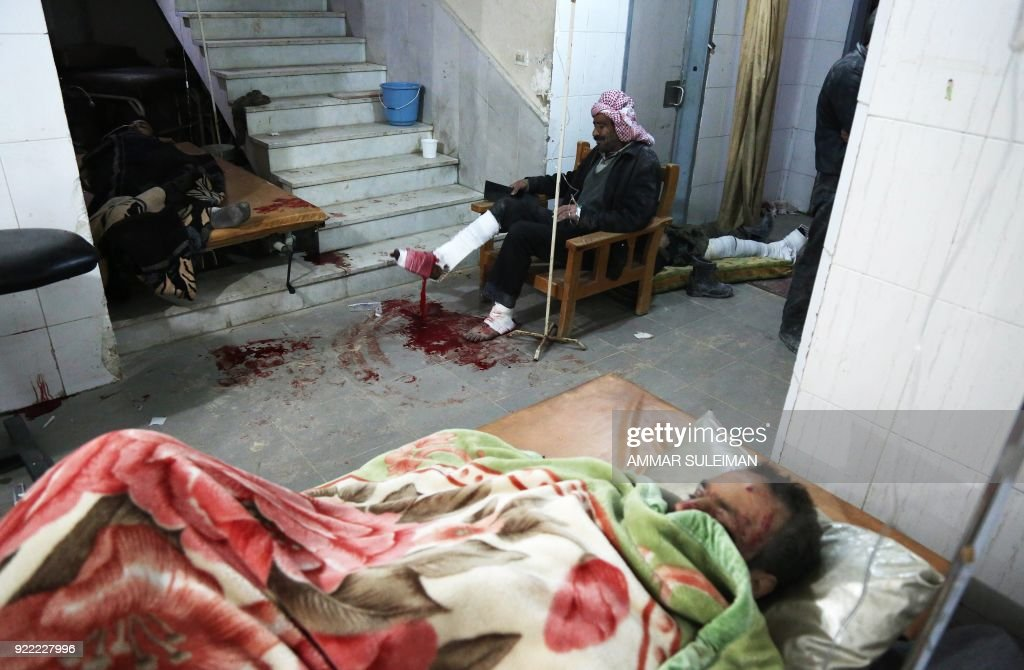 Wounded Syrians wait for treatment at a make-shift hospital in Kafr Batna following Syrian government bombardments on the besieged Eastern Ghouta region on the outskirts of the capital Damascus on February 21, 2018. Syrian jets carried out more deadly raids on Eastern Ghouta as Western powers and aid agencies voiced alarm over the mounting death toll and spiralling humanitarian catastrophe. PHOTO / Ammar SULEIMAN