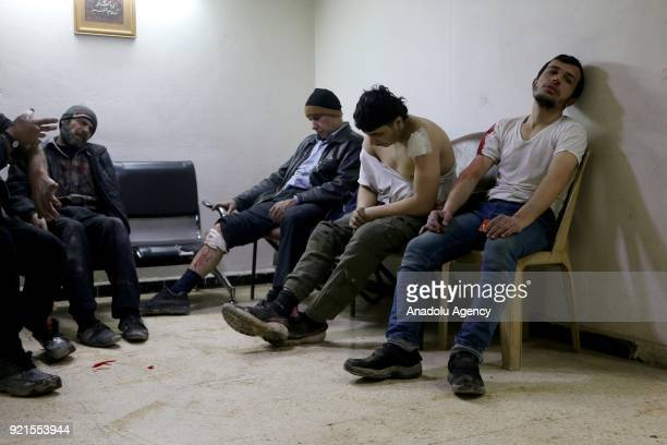 Wounded Syrians wait to receive medical treatment at a hospital after Assad Regime's airstrikes hit Zamalka town of Eastern Ghouta deescalation zone...
