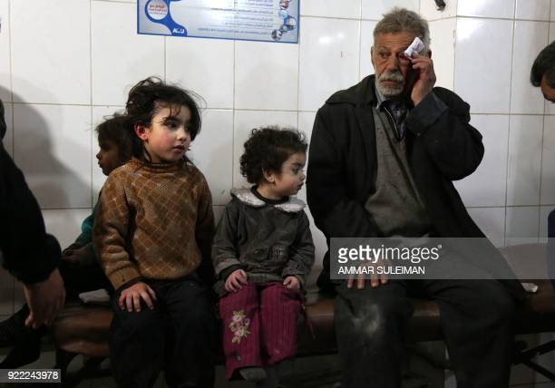 Wounded Syrians wait to receive treatment at a makeshift hospital in Kafr Batna following Syrian government bombardments on the besieged Eastern...