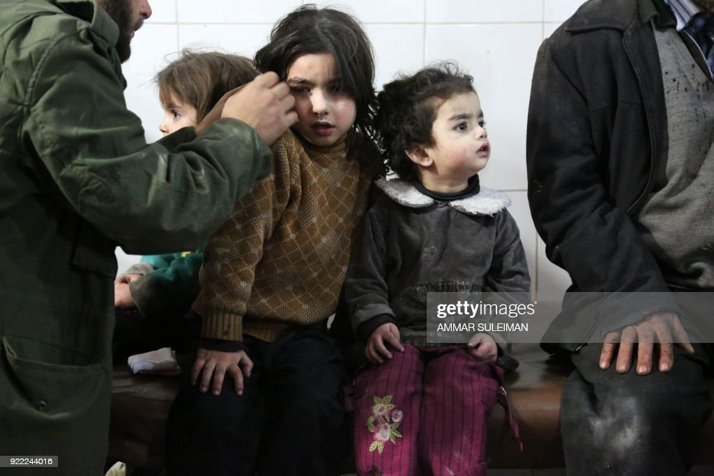 Wounded Syrians wait to receive treatment at a make-shift hospital in Kafr Batna following Syrian government bombardments on the besieged Eastern Ghouta region on the outskirts of the capital Damascus on February 21, 2018. Syrian jets carried out more deadly raids on Eastern Ghouta as Western powers and aid agencies voiced alarm over the mounting death toll and spiralling humanitarian catastrophe. PHOTO / Ammar SULEIMAN