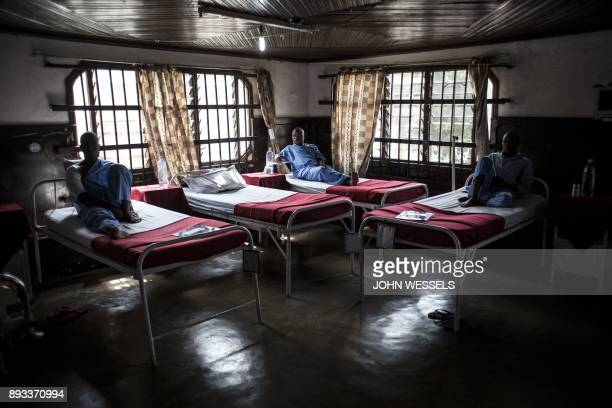 TOPSHOT Wounded Tanzanian peacekeepers sit in beds as they recover from their wounds on December 15 2017 in Goma Tanzania called on December 14 2017...