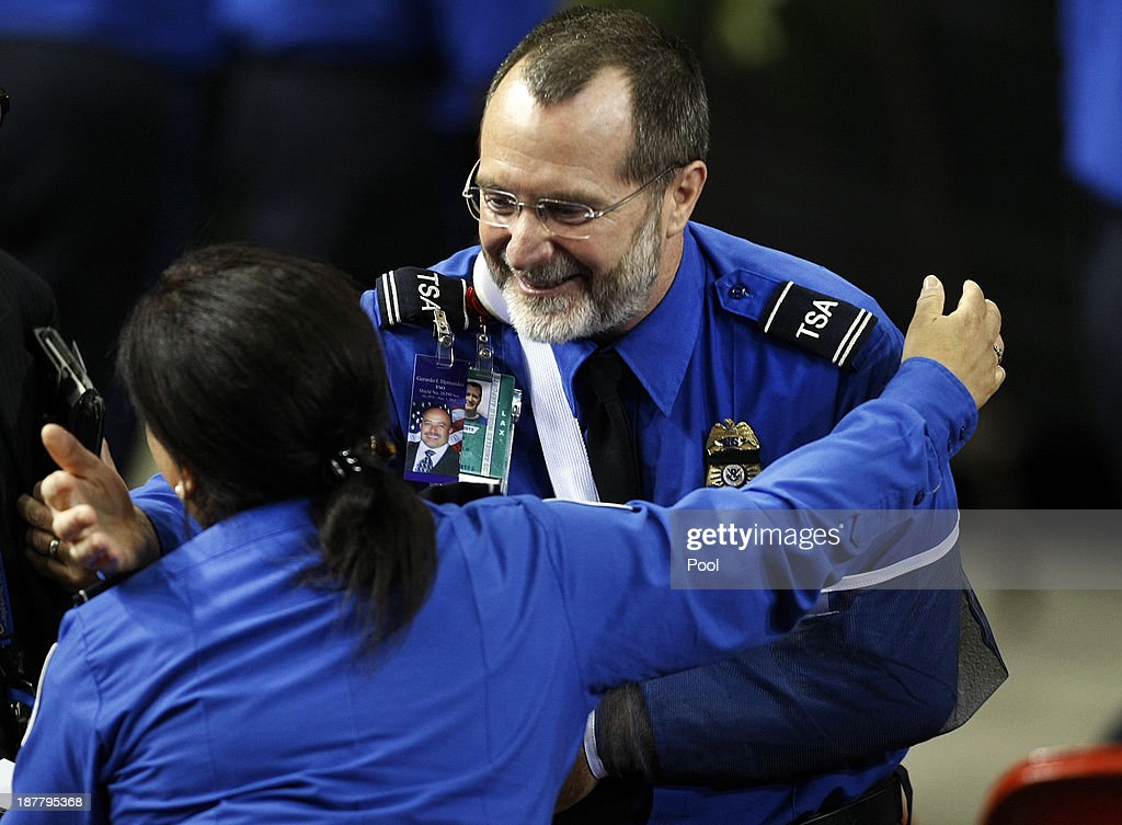 wounded transportation security officer james speer right gets hugs from fellow officers at the - Transportation Security Officer