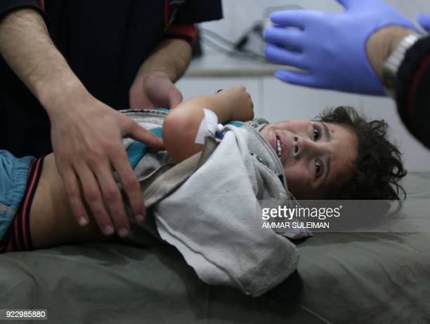 Wounded twoandhalf Syrian child Mohammed Malas lies at a makeshift clinic following Syrian government bombardments in Kafr Batna in the besieged...