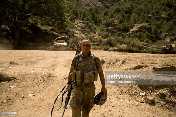 A wounded US Army soldier from the 10th Mountain Division comes off a hill and is soon attended to by a physician in Kamdesh Nuristan August 27...