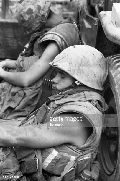 A wounded US Marine rests in a building that has been cleared of Communist troops during fighting in Hue Marines sped to Hue to aid in recapture of...