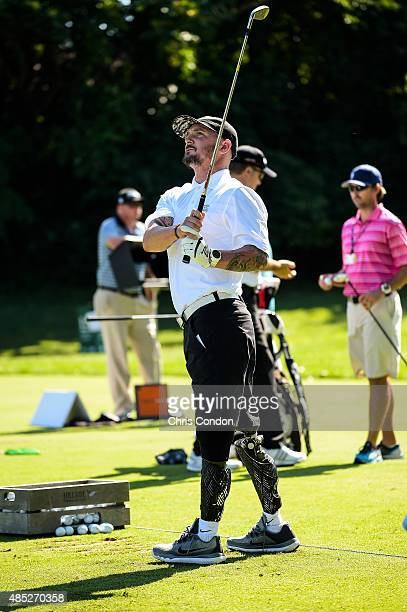 Wounded veteran Kevin McCloskey hits an iron after getting fitted for clubs at a Birdies for the Brave Callaway Warrior Club Fitting event during...