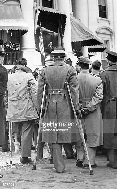 Wounded veterans attend Franklin D Roosevelt's 4th Presidential Inauguration speech January 20 1945 at the White House in Washington DC