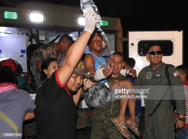 A wounded victim of the explosion inside the catholic cathedral is carried to a military plane in Jolo town sulu province in southern island of...