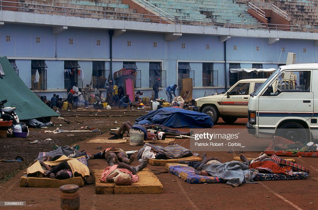 Wounded victims wait for help after the Amahoro Stadium was bombed by the army during the civil war in Rwanda.