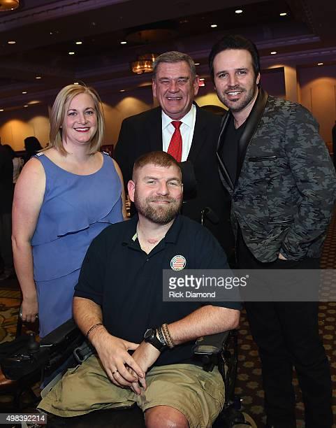 Wounded Warrior Ed Matayka, Karen Matayka, Executive Director Helping a Hero Bob Clark and Singer/Songwriter Mark Wills attend the 2015 Helping A...