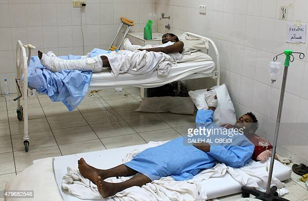 Wounded Yemeni men rest in the Sadaka hospital in Aden the largest city in southern Yemen on July 5 2015 Overwhelmed by the flood of sick and injured...