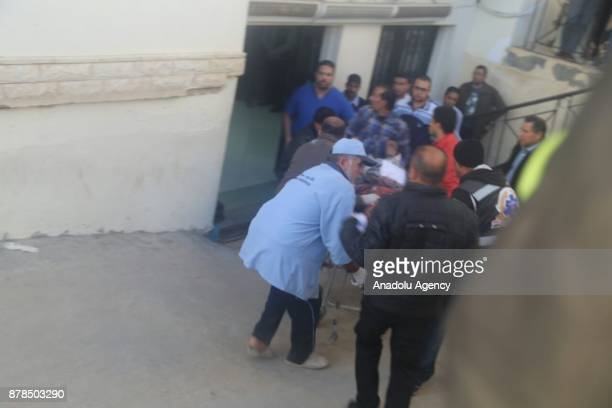 Woundeds are taken to the hospital after the Egypt Sinai mosque bombing in AlArish Egypt on November 24 2017 The death toll from a bomb that went off...