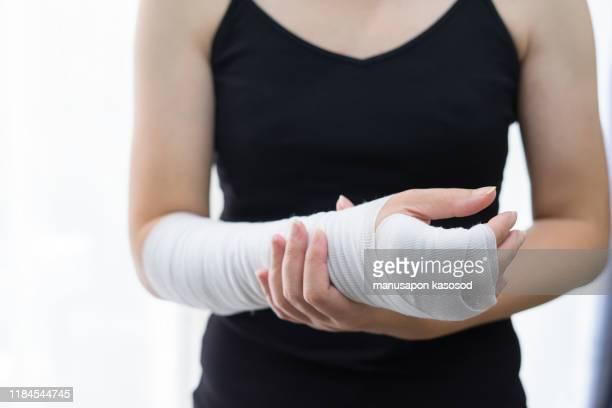 wounds at the wrist,bandages a hand wound pain medicine - cut wrists stock pictures, royalty-free photos & images