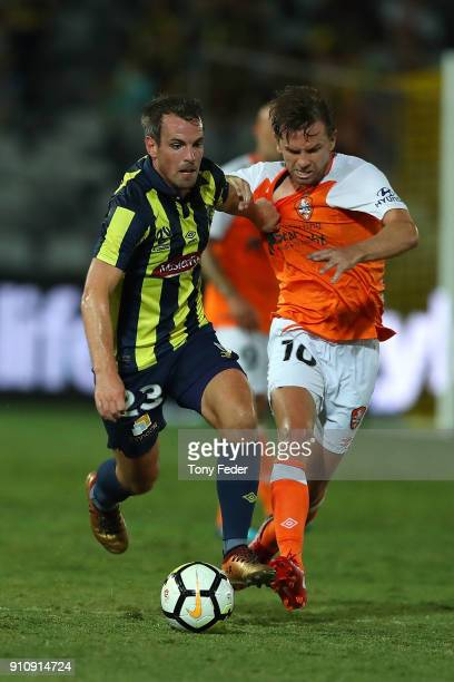 Wout Brama of the Mariners contests the ball with Brett Holman of the Roar during the round 18 ALeague match between the Central Coast Mariners and...