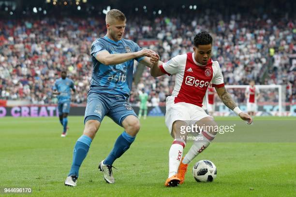 Wout Droste of Heracles Almelo Justin Kluivert of Ajax during the Dutch Eredivisie match between Ajax Amsterdam and Heracles Almelo at the Amsterdam...