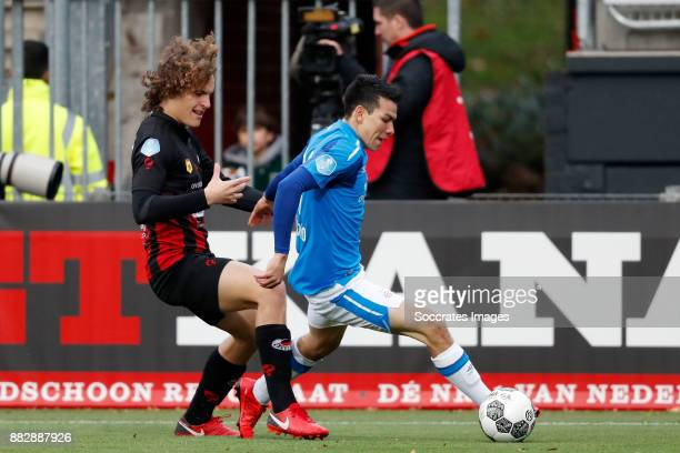 Wout Faes of Excelsior Hirving Lozano of PSV during the Dutch Eredivisie match between Excelsior v PSV at the Van Donge De Roo Stadium on November 26...