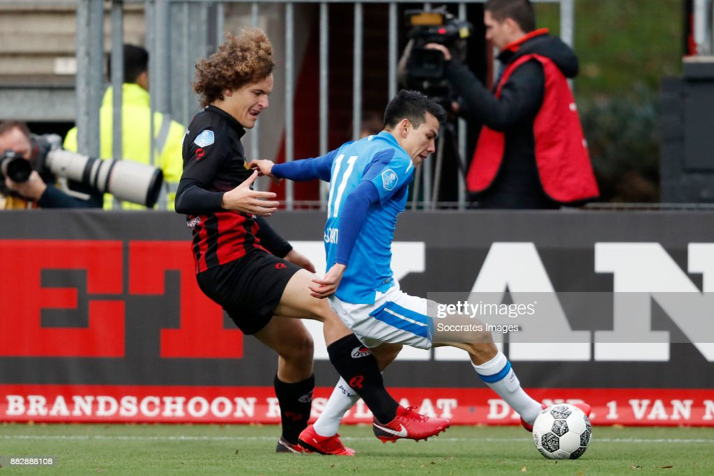 Wout Faes of Excelsior, Hirving Lozano of PSV during the Dutch Eredivisie match between Excelsior v PSV at the Van Donge & De Roo Stadium on November 26, 2017 in Rotterdam Netherlands