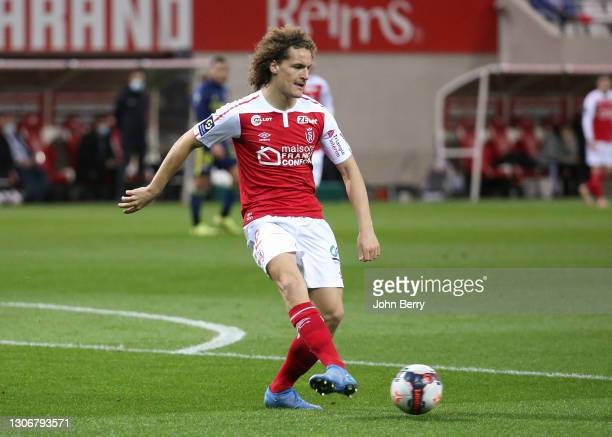 Wout Faes of Reims during the Ligue 1 match between Stade de Reims and Olympique Lyonnais at Stade Auguste Delaune on March 12, 2021 in Reims, France.