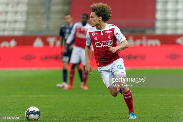 Wout Faes of Stade de Reims in action during the Ligue 1 match between Stade Reims and Olympique Marseille at Stade Auguste Delaune on April 23, 2021...