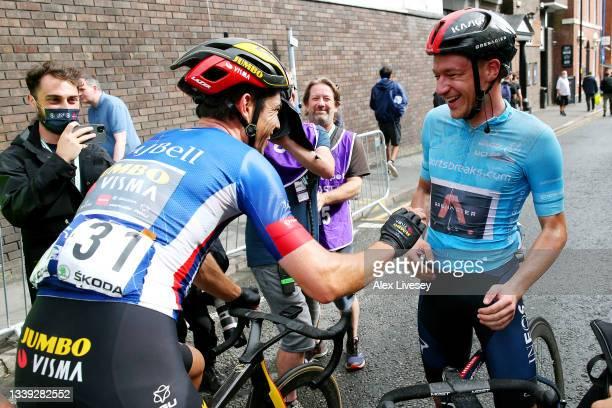 Wout Van Aert of Belgium and Team Jumbo - Visma blue leader jersey congratulates Ethan Hayter of United Kingdom and Team INEOS Grenadiers turquoise...