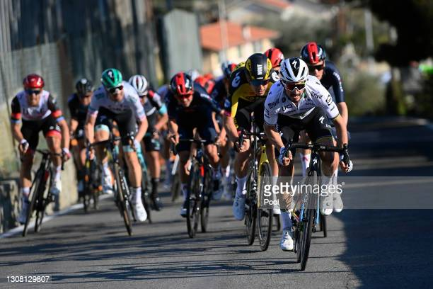 Wout Van Aert of Belgium and Team Jumbo - Visma & Julian Alaphilippe of France and Team Deceuninck - Quick-Step during the 112th Milano-Sanremo 2021...