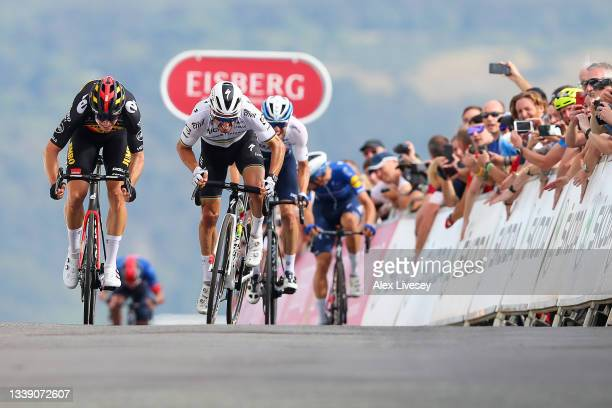 Wout Van Aert of Belgium and Team Jumbo - Visma sprints at finish line to win the stage ahead of Julian Alaphilippe of France and Team Deceuninck -...