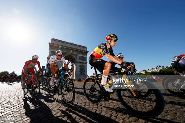 Wout Van Aert of Belgium and Team Jumbo-Visma & The Peloton passing in front of The Arc De Triomphe at Paris City during the 108th Tour de France...