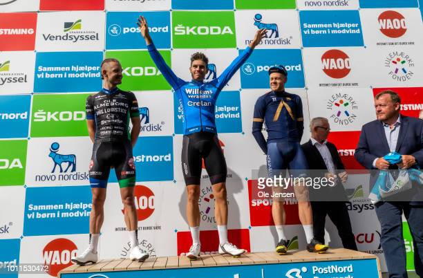 Wout van Aert of Belgium and team Veranda's WillemsCrelan celebrates winning Tour of Denmark with third place Lasse Norman Hansen of Denmark and team...
