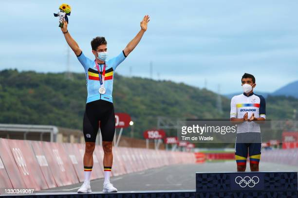 Wout van Aert of Team Belgium poses with the silver medal & Richard Carapaz of Team Ecuador gold medallist after the Men's road race at the Fuji...