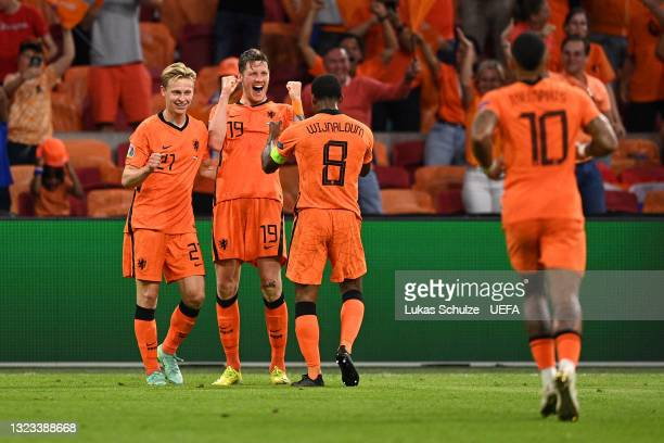 Wout Weghorst of Netherlands celebrates with Frenkie de Jong and Georginio Wijnaldum after scoring their side's second goal during the UEFA Euro 2020...