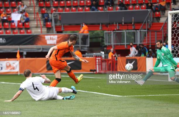 Wout Weghorst of Netherlands scores their side's second goal past Giorgi Loria of Georgia during the international friendly match between Netherlands...