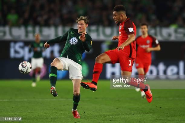 Wout Weghorst of VfL Wolfsburg battles for the ball with Simon Falette of Eintracht Frankfurt during the Bundesliga match between VfL Wolfsburg and...
