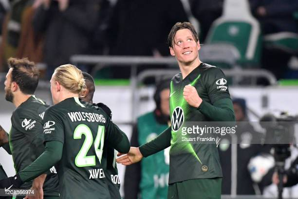 Wout Weghorst of VfL Wolfsburg celebrates after Admir Mehmedi scores his team's first goal during the Bundesliga match between VfL Wolfsburg and...