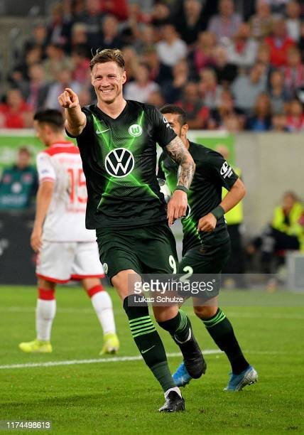 Wout Weghorst of VfL Wolfsburg celebrates after he scores his teams opening goal during the Bundesliga match between Fortuna Duesseldorf and VfL...