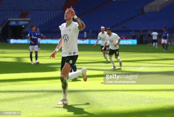 Wout Weghorst of VfL Wolfsburg celebrates after scoring his second goal during the Bundesliga match between FC Schalke 04 and VfL Wolfsburg at...