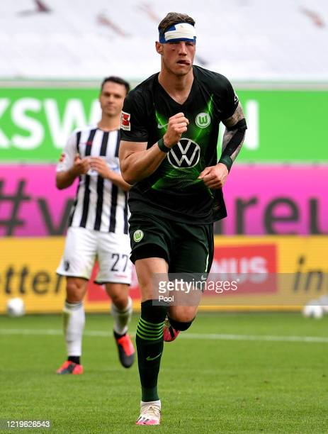 Wout Weghorst of VfL Wolfsburg celebrates after scoring his team's second goal, from a penalty during the Bundesliga match between VfL Wolfsburg and...