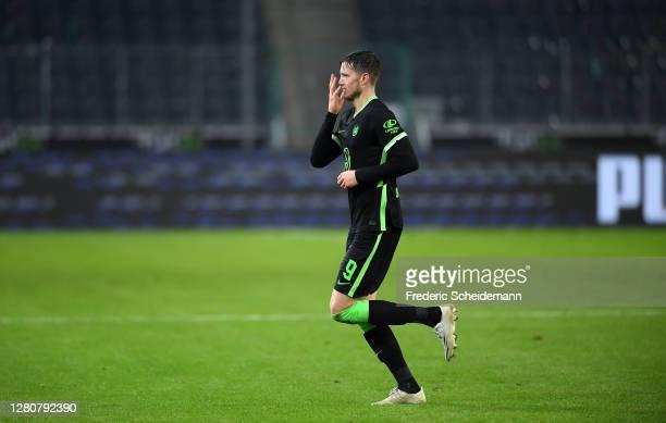 Wout Weghorst of VfL Wolfsburg celebrates after scoring his team's first goal during the Bundesliga match between Borussia Moenchengladbach and VfL...