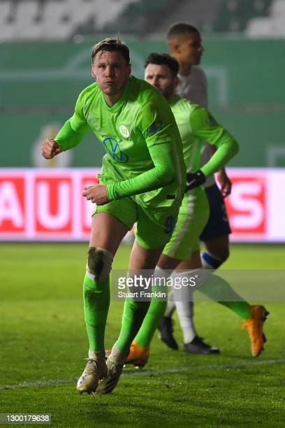 Wout Weghorst of VfL Wolfsburg celebrates after scoring his team's first goal during the DFB Cup Round of Sixteen match between VfL Wolfsburg and FC...