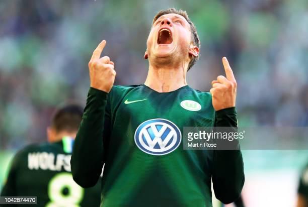 Wout Weghorst of VfL Wolfsburg celebrates after scoring the second equalising goal during the Bundesliga match between VfL Wolfsburg and Borussia...
