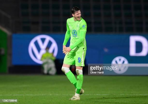 Wout Weghorst of VfL Wolfsburg celebrates after scoring their sides second goal during the Bundesliga match between VfL Wolfsburg and Eintracht...