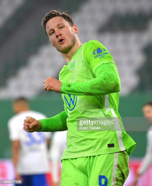 Wout Weghorst of VfL Wolfsburg celebrates after scoring their side's first goal during the DFB Cup Round of Sixteen match between VfL Wolfsburg and...