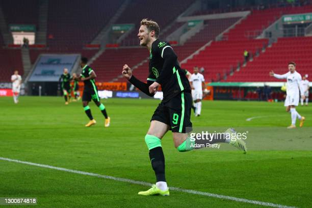 Wout Weghorst of VfL Wolfsburg celebrates after scoring their side's first goal during the Bundesliga match between FC Augsburg and VfL Wolfsburg at...