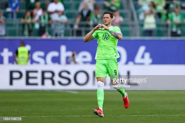 Wout Weghorst of VfL Wolfsburg celebrates after scoring their side's first goal during the Bundesliga match between VfL Wolfsburg and VfL Bochum at...
