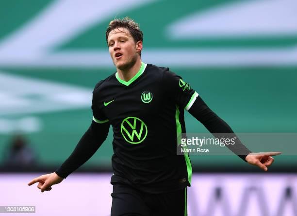 Wout Weghorst of VfL Wolfsburg celebrates after scoring their team's second goal during the Bundesliga match between SV Werder Bremen and VfL...
