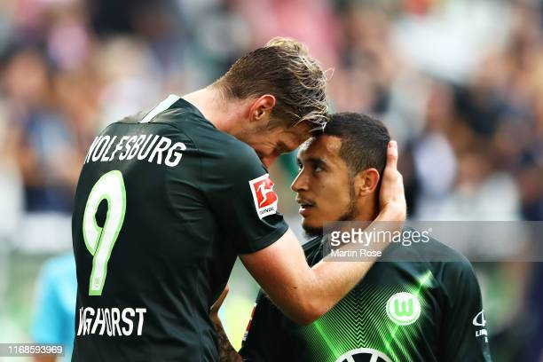 Wout Weghorst of VfL Wolfsburg celebrates scoring his sides second goal with teammate William during the Bundesliga match between VfL Wolfsburg and 1...